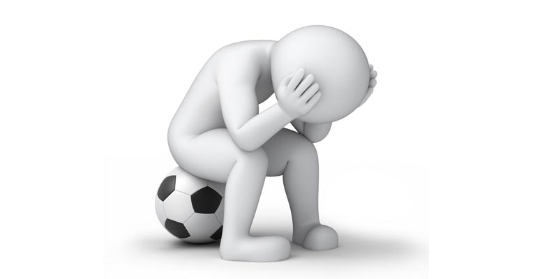 Soccer character slumping on a football