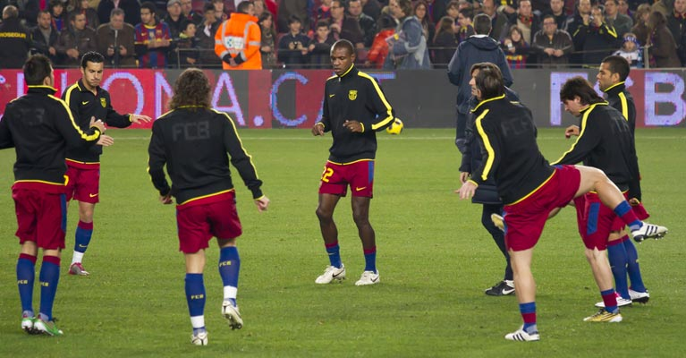 Professional football team warming up for a game