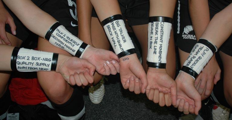 Women's Football Team with Dan Abrahams Script on their arms