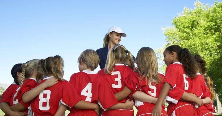 Coach with young soccer players