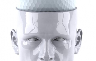 Statue with a golf ball brain