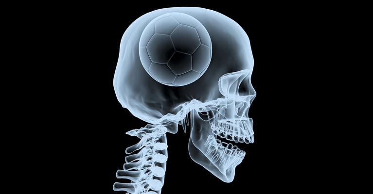 Skeleton with a football psychologist brain