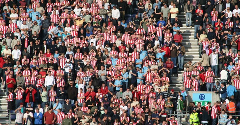 A stadium of football fans