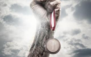 Fist holding aloft a medal