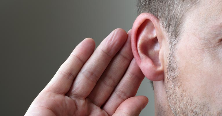 Hand to the ear listening photo