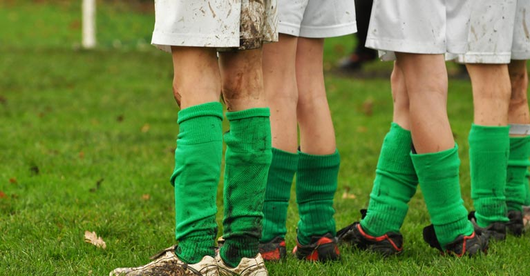 Legs of kids football team